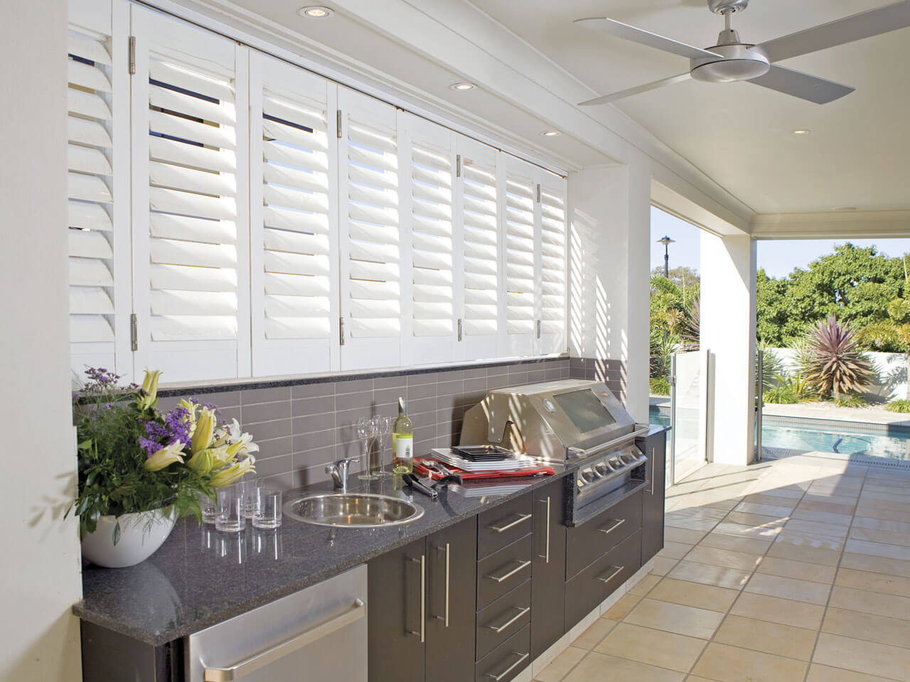 Modern plantation shutters on patio
