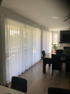 Curtains in a large room can help the room feel cozier.
