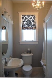 A blind in a small room can help the room feel more put together.