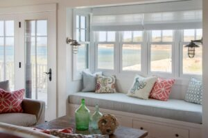 Roman blinds bring softness with furniture underneath.